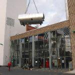 ...inserting the new steam boiler